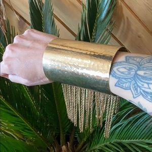 Gold tassel wrist cuff